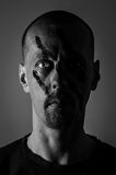 War Mask Portrait. Self portrait of man with painted on war mask Stock Photos