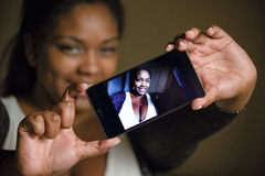 Self portrait. Overweight woman self portrait with mobile phone Royalty Free Stock Photos