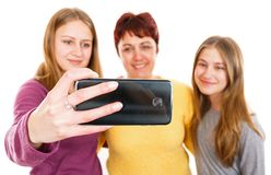 Happy mother with daughters. Self portrait photo of happy mother with daughters Stock Photo