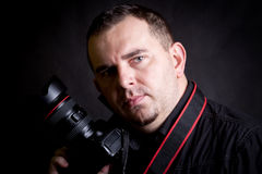 Self portrait of the photographer with camera Royalty Free Stock Photos