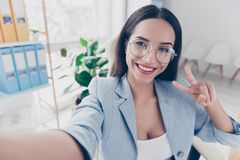 Self portrait of pretty, charming, cheerful woman in formalwear royalty free stock images