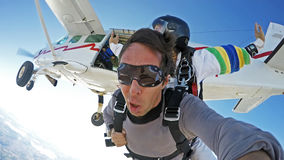 Self portrait skydiving tandem jump from the plane Stock Images