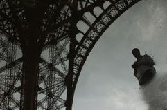 Self-portrait under the Eiffel Tower reflected in a puddle stock photos