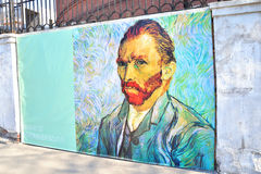 Self-portrait of Vincent Willem van Gogh on the fence. ST.PETERSBURG, RUSSIA - 3 MAY 2016: Advertising poster of self-portrait of Vincent Willem van Gogh on the stock photo