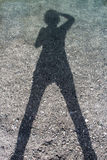 Self portrait. Woman photographing his own shadow in the torrent royalty free stock photography