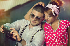 Self-portrait. Young couple in love making self-portrait. Retro style Stock Photo