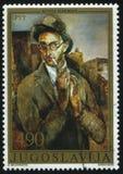 Self-portrait of Yugoslavian artist Kosta Hakman. RUSSIA KALININGRAD, 12 NOVEMBER 2016: stamp printed by Yugoslavia, shows the self-portrait of Yugoslavian Stock Photo