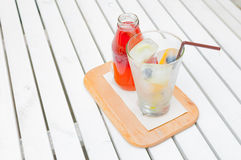 Self pouring ice tea serve with ice cube with fruits frozen insi. De Stock Image