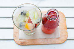 Self pouring ice tea serve with ice cube with fruits frozen insi Stock Images