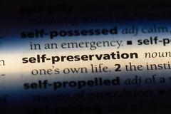 Self preservation. Word in a dictionary.  concept royalty free stock photography