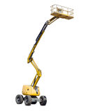 Self propelled articulated boom lift on a light background Royalty Free Stock Images