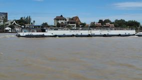 A self-propelled barge goes up Chao Phraya River. On September 3, 2017 in the city of Pakkret in Nonthaburi province, Thailand stock video footage