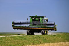 Self propelled combines travels on road Royalty Free Stock Photo