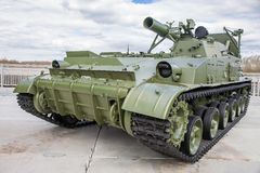 Self-propelled mortar. Long rifled barrel. Against the bright sky. Self-propelled gun green. Military action. Four lights on the armor. The armored vehicle Royalty Free Stock Photography