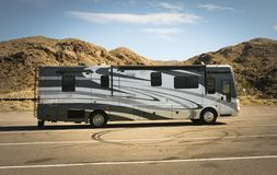 Self-propelled recreational vehicle parking in the desert Royalty Free Stock Photo