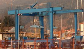 Shipyard crane, blue gantry self propelled royalty free stock photos