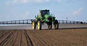 Self-propelled sprayer with the navigator_5. Chortkiv - Ternopil - Ukraine - April 5, 2017. In the agricultural enterprise `Bell` self-propelled sprayer with GPS Stock Image