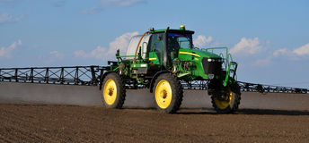 Self-propelled sprayer with the navigator_7. Chortkiv - Ternopil - Ukraine - April 5, 2017. In the agricultural enterprise `Bell` self-propelled sprayer with GPS Royalty Free Stock Image