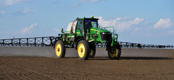 Self-propelled sprayer with the navigator_8. Chortkiv - Ternopil - Ukraine - April 5, 2017. In the agricultural enterprise `Bell` self-propelled sprayer with GPS Stock Photo