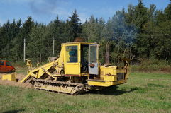Self-propelled unit for piping. Diesel unit is working on digging trenches and laying pipe. Plant on crawlers. Works are carried out in the summer in good Stock Photos