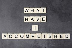 What have I accomplished motivational phrase formed with tile letters. Self-question to inspire and motivate royalty free stock photography