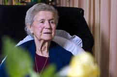 Self-reliant senior lady. Sitting in her lounge room Stock Images