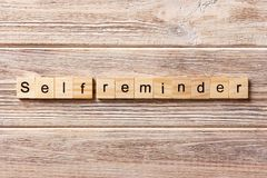 Self reminder word written on wood block. self reminder text on table, concept.  Royalty Free Stock Images