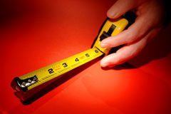 Self Retracting Tape Measure Tool in Woman Hand stock image