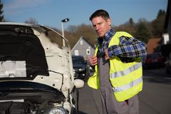 Self safety protection during car maintenance Royalty Free Stock Images