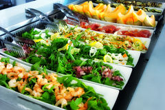 Self Service Buffet. Steel trays filled with delicious food at self service restaurant Royalty Free Stock Photos