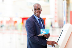 Self service check in. African businessman using self service check in machine in airport Stock Photography