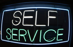 Self Service Neon. Sign Laundromat Royalty Free Stock Photography