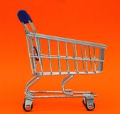 Self-service supermarket full shopping trolley cart on colorful background stock photo