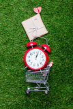 Self-service supermarket shopping trolley cart with gift box and Royalty Free Stock Photos