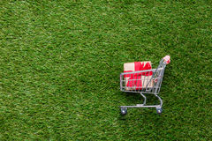 Self-service supermarket shopping trolley cart with gift box Stock Image