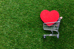 Self-service supermarket shopping trolley cart and heart shape g Royalty Free Stock Photo