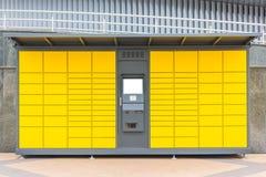 Self-service terminal. In yellow facade Royalty Free Stock Photo