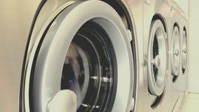 Self service washing machine working. Close up of industrial self service washing machine working stock video