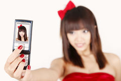 Self shot. Chinese girl taking a self shot on white Royalty Free Stock Image