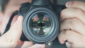 Self shot of a photographer. Closeup lens Royalty Free Stock Images