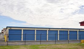 Self-Store Storage Units. Self storage facilities featuring secure units, on-site management, 24 hour access and alarmed storage units for moving as well as royalty free stock image