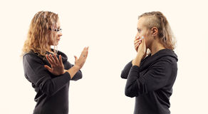 Self talk concept. Young woman talking to herself, showing gestures. Double portrait from two different side views. Royalty Free Stock Photos