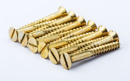 Self-tapping screw, yellow, close-up photo. On white background Stock Image