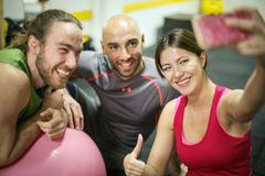 Self time. Three friends in the gym making self photo Stock Images