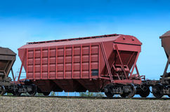 Self-unloading wagon. Self-unloading hopper wagon for transportation of dry bulk cargoes royalty free stock images