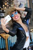 Selfi portrait girl curly. Selfi happy smiling positive portrait girl curly spring sun  outside Stock Photos