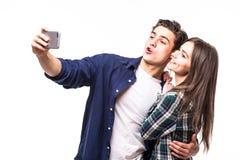 Selfie взятия пар на белизне Стоковое фото RF