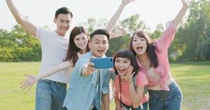 Selfie людей счастливо стоковое фото rf
