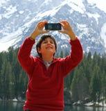 Selfie ребенка с предпосылкой dolomities Стоковые Фотографии RF