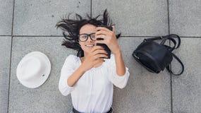 Selfie. Above viwe of young happy girl with smarthphone photogra stock photo
